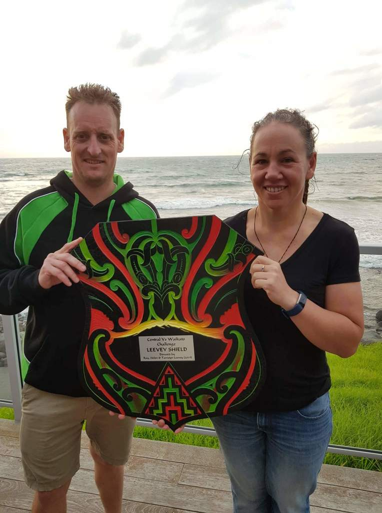 Squash Centrals team captains Kent Darlington & Tamsyn Leevey with the spoils of the 2019 Leevey Shield after defeating Waikato.jpeg